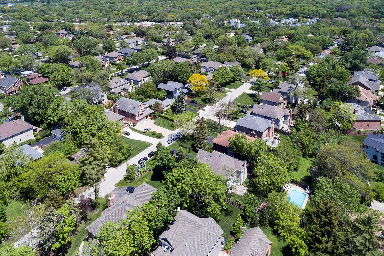 Aerial view of a neighborhood with mature trees in a